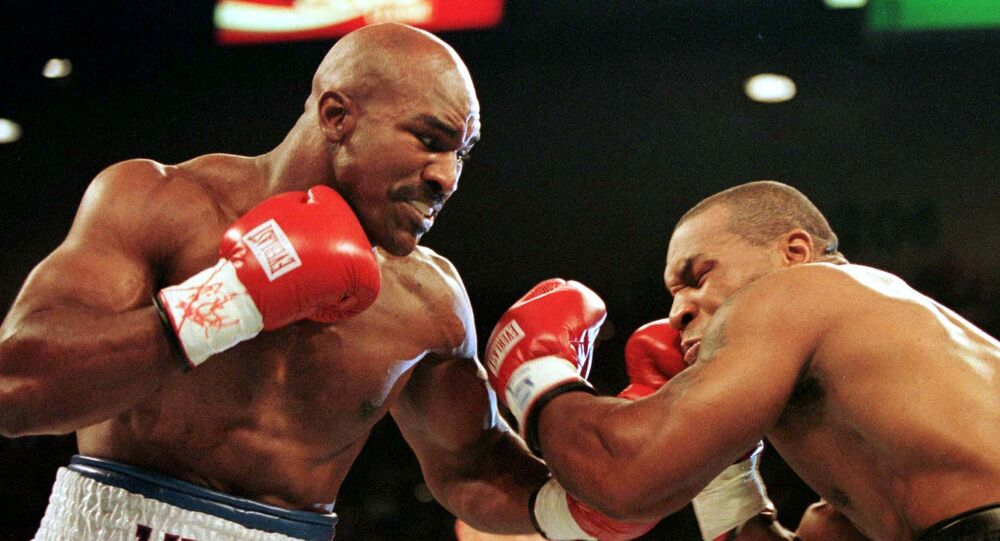Evander Holyfield connects to the jaw of challenger Mike Tyson in the first round of their second fight in 1997
