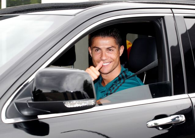 Juventus' Cristiano Ronaldo gestures as he leaves Juventus Training Center following the outbreak of the coronavirus disease (COVID-19), Turin, Italy, May 19, 2020