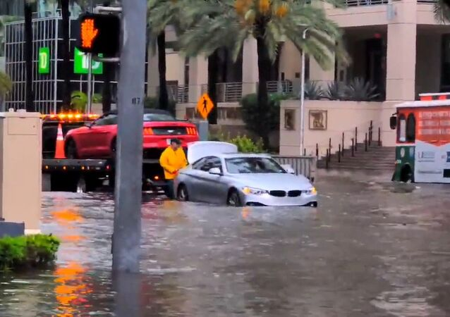 Traffic navigate flood waters in Miami, Florida, U.S. May 25, 2020, in this still image obtained from a social media video. Courtesy of Ryan Rea/Social Media via REUTERS. ATTENTION EDITORS - THIS IMAGE HAS BEEN SUPPLIED BY A THIRD PARTY. MANDATORY CREDIT RYAN REA. NO RESALES. NO ARCHIVES.