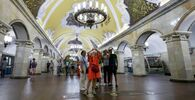 Tourists marvel at the sumptuous interior of the Komsomolskaya station.