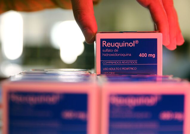 A health worker holds a box of hydroxychloroquine at the pharmacy of the Nossa Senhora da Conceicao hospital, amid the coronavirus disease (COVID-19) outbreak in Porto Alegre, Brazil, May 26, 2020