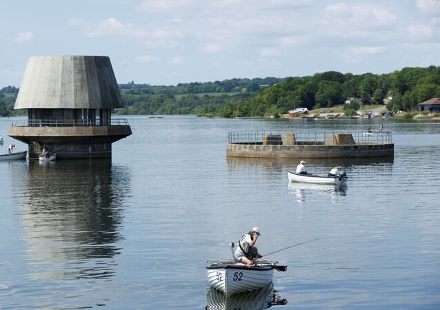 People are seen fishing from boats at Bewl Water Country Park, following the outbreak of the coronavirus disease (COVID-19), Wadhurst, Britain, May 27, 2020.