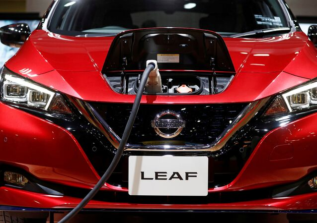 A charging cable is attached to a Nissan Leaf electric car at the Tokyo Motor Show, in Tokyo, Japan October 24, 2019.
