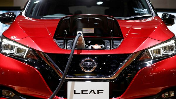 A charging cable is attached to a Nissan Leaf electric car at the Tokyo Motor Show, in Tokyo, Japan October 24, 2019.  - Sputnik International