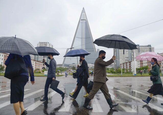 People wearing protective face masks in Pyongyang