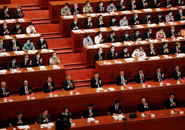 Chinese President Xi Jinping and other officials applaud after the vote on the national security legislation for Hong Kong Special Administrative Region at the closing session of the National People's Congress (NPC) at the Great Hall of the People in Beijing, China May 28, 2020.