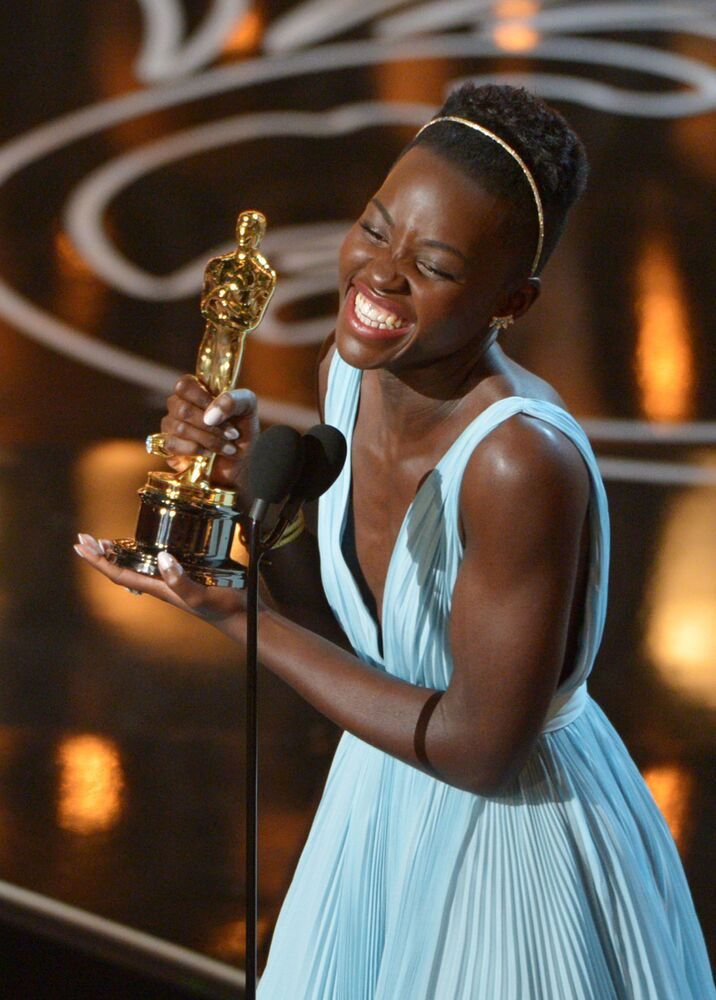 In this March 2, 2014 file photo, Lupita Nyong'o accepts the award for best actress in a supporting role for 12 Years a Slave during the Oscars in Los Angeles.