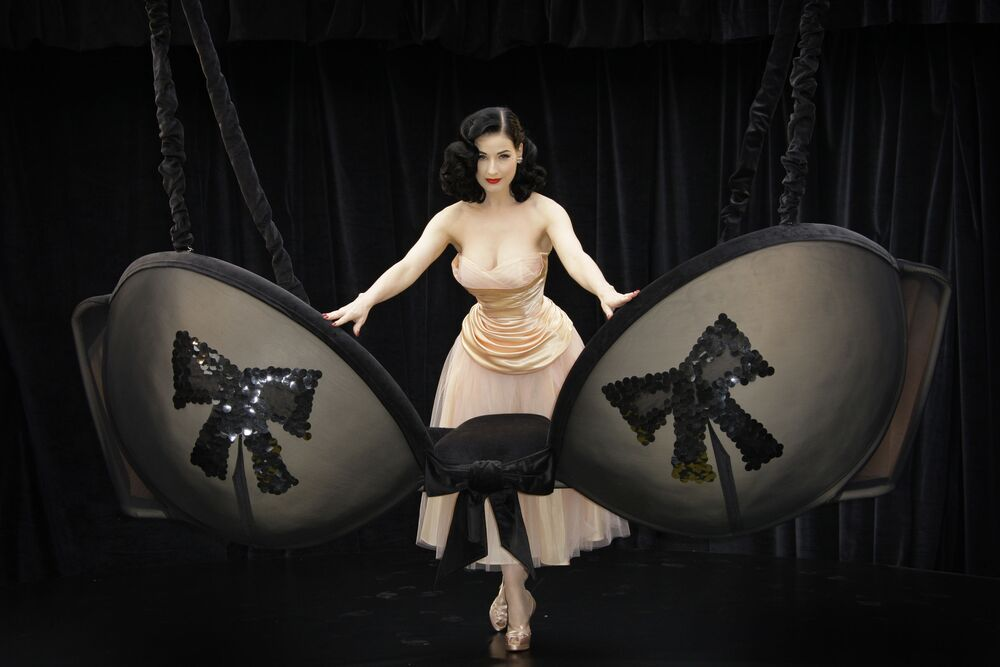 U.S. burlesque dancer Dita Von Teese reveals a giant Wonderbra, to celebrate a new collection of lingerie she designed which was inspired by her love of the burlesque scene and 1940's glamour, in central London, Tuesday Sept. 23 2008.