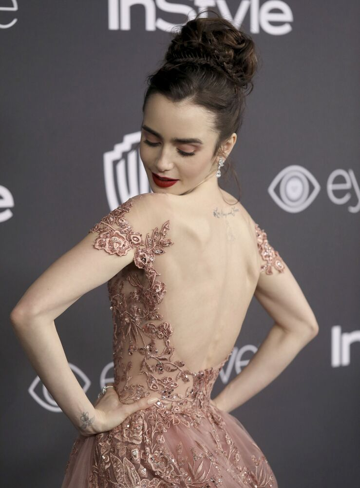 Lily Collins arrives at the InStyle and Warner Bros. Golden Globes afterparty at the Beverly Hilton Hotel on Sunday, Jan. 8, 2017, in Beverly Hills, Calif.