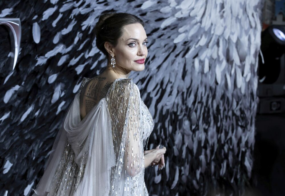 Actress Angelina Jolie poses for photographers on arrival at the European premiere of the film 'Maleficent Mistress of Evil' in central London on Wednesday, Oct. 9, 2019.