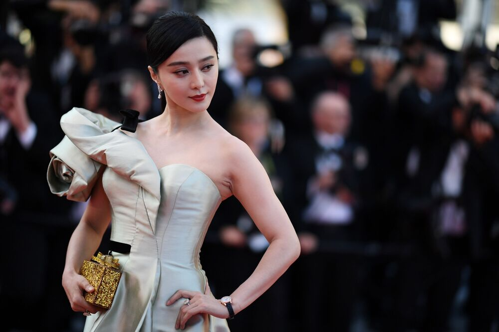 Chinese actress Fan Bingbing poses as she arrives on May 11, 2018 for the screening of the film Ash is Purest White (Jiang hu er nv) at the 71st edition of the Cannes Film Festival in Cannes, southern France.