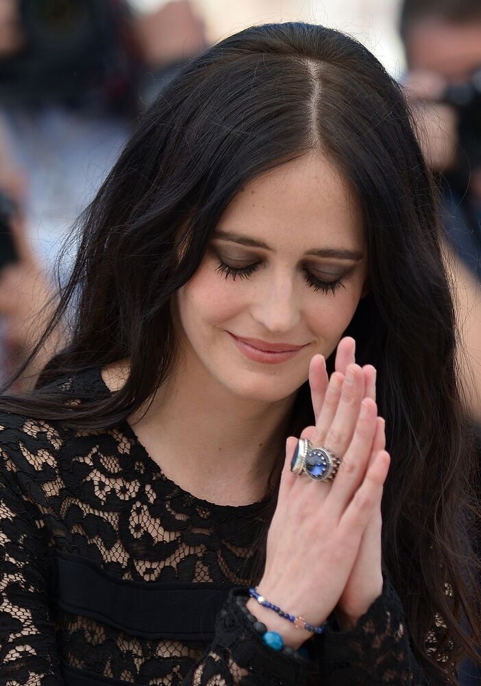 French actress Eva Green poses during a photocall for the film The Salvation at the 67th edition of the Cannes Film Festival in Cannes, southern France, on May 17, 2014.