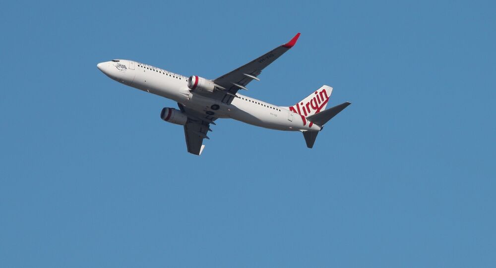 A Virgin Australia Airlines plane takes off from Kingsford Smith International Airport in Sydney, Australia, March 18, 2020