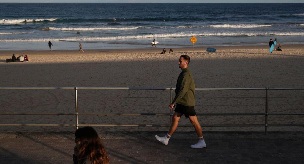People stroll along a boardwalk amidst the easing of the coronavirus disease (COVID-19) restrictions at Bondi Beach in Sydney, Australia, May 27, 2020.