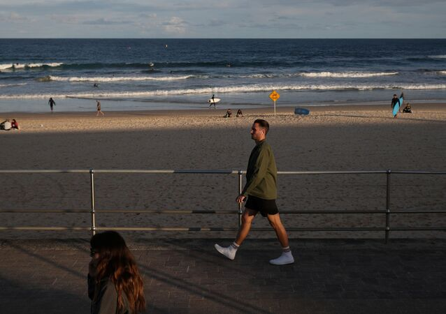 People stroll along a boardwalk amidst the easing of the coronavirus disease (COVID-19) restrictions at Bondi Beach in Sydney, Australia, May 27, 2020.