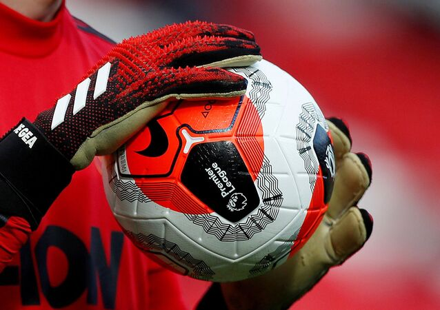 General view of a match ball held by Manchester United's David de Gea during the warm up before the match