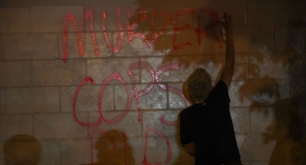 Protesters vandalize an O'Reilly's near the Minneapolis Police third precinct, where they gathered after a white police officer was caught on a bystander's video pressing his knee into the neck of African-American man George Floyd, who later died at a hospital, in Minneapolis, Minnesota, U.S. May 27, 2020. REUTERS/Nicholas Pfosi