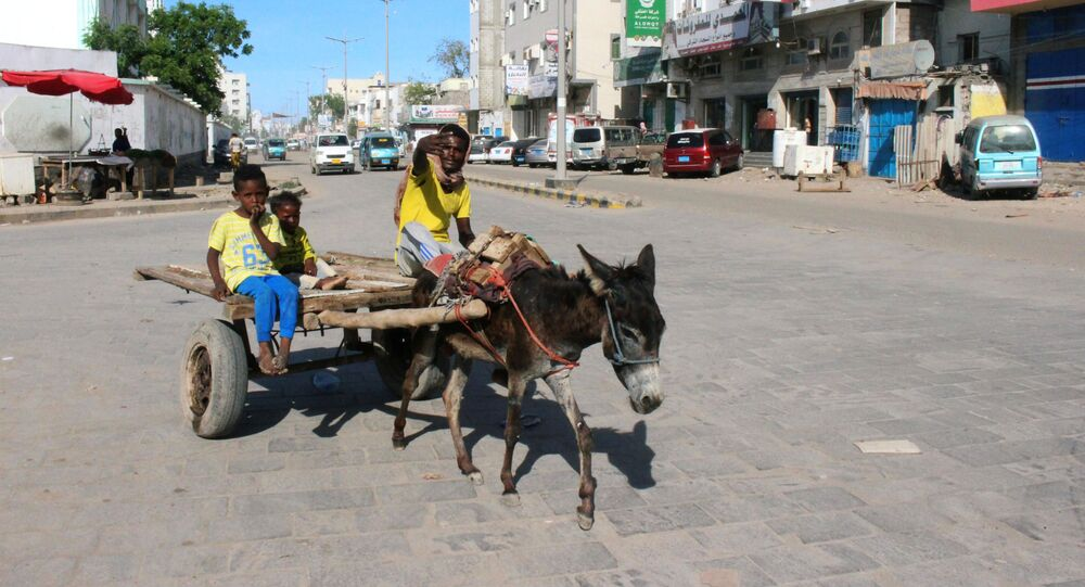 A man gestures as he rides on a donkey-drawn cart during a curfew amid concerns about the spread of the coronavirus disease (COVID-19) in Aden, Yemen April 30, 2020.