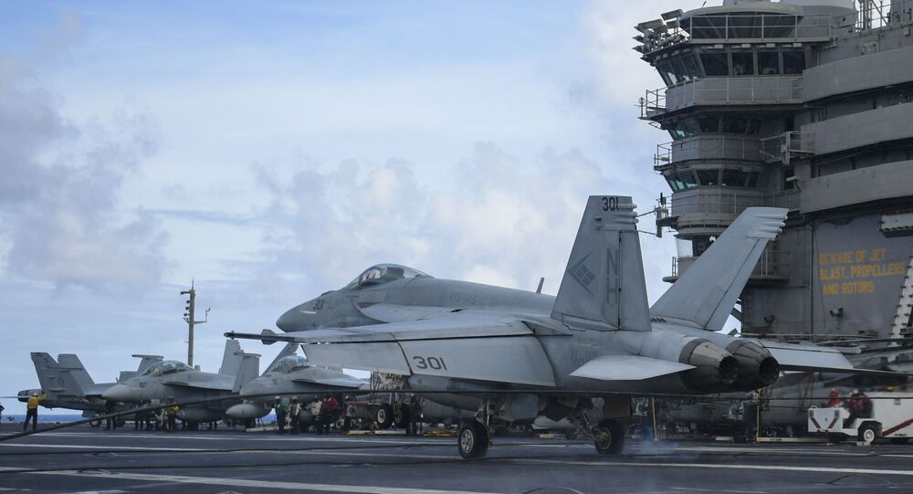 """An F/A-18E Super Hornet, assigned to the """"Blue Diamonds"""" of Strike Fighter Squadron (VFA) 146, lands on the flight deck of the aircraft carrier USS Theodore Roosevelt (CVN 71) May 25, 2020"""