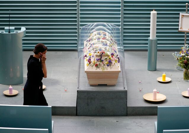A coffin is standing under a plastic cover due to hygiene protection precautions, while undertaker Cassandra Yousef makes final preparations for the funeral service, amid the spread of the coronavirus disease (COVID-19) in Berlin, Germany, May 28, 2020.