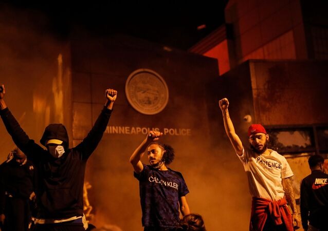 Protesters set fire to the entrance of a police station amid riots after a white police officer was caught on a bystander's video pressing his knee into the neck of African-American man George Floyd, who later died, in Minneapolis, Minnesota, 28 May 2020.