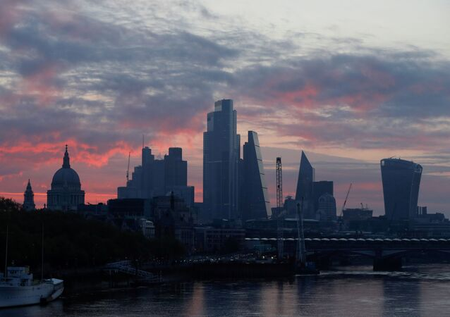 St Pauls cathedral and the City of London financial district are seen at dawn as the spread of coronavirus disease (COVID-19) continues in London, Britain, April 19 2020.