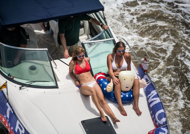 Boaters participate in the Make America Great Again parade on 24 May 2020 in Charleston, South Carolina. A Facebook post noted the event, which was scheduled to begin at the US Coast Guard station on the battery in Downtown Charleston and wind its way up the harbour, was hosted by OSR Marine, a marine supply store.