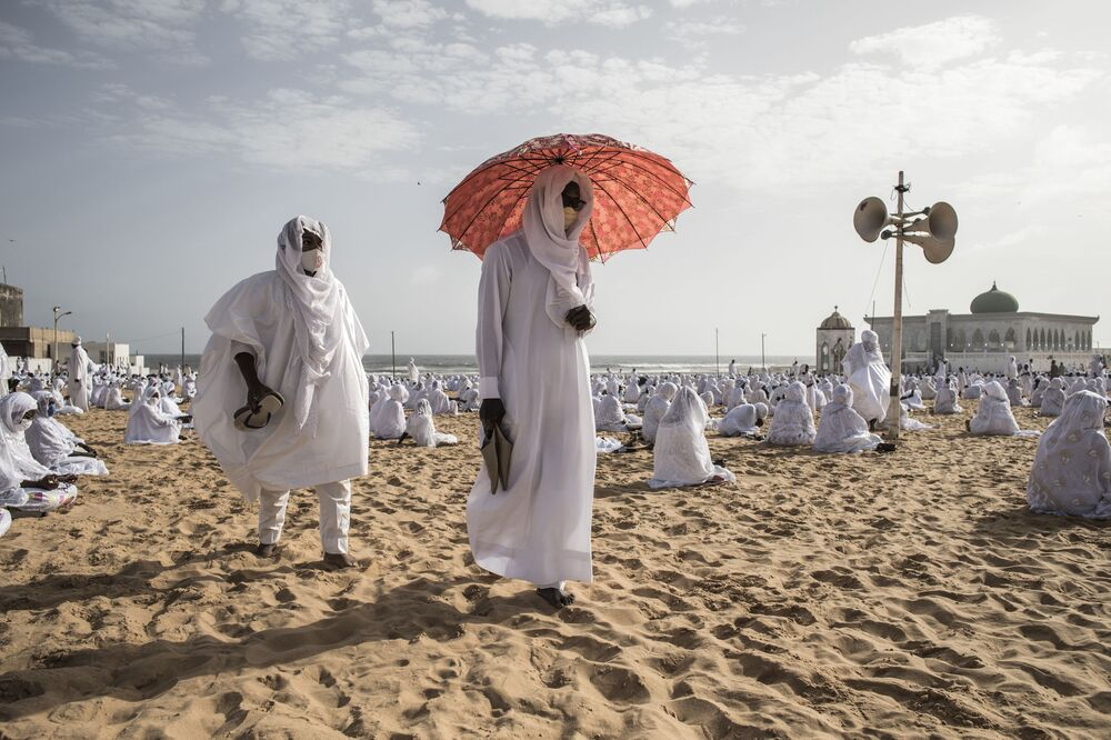 Followers of the Layene community leave the beach in front of the Yoff Layene Mosque, at the end of the Islamic festivity of Korite in Dakar, Senegal, on 24 May 2020, Korite marks the end Muslim Holy month of Ramadan.