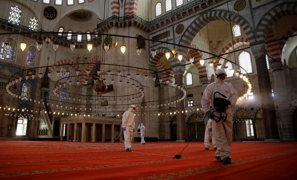 Fatih Municipality workers disinfect Suleymaniye Mosque, which is locked down for more than six weeks and will be partly open again for prayers next Friday, during the third day of Eid and the last day of a four-day curfew, amid the coronavirus disease (COVID-19) outbreak, in Istanbul, Turkey 26 May 2020.