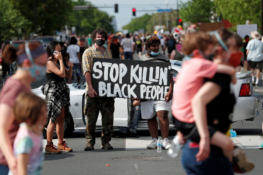 Protesters gather at the scene where George Floyd, an unarmed black man, was pinned down by a police officer kneeling on his neck before later dying in hospital in Minneapolis, Minnesota, US 26 May 2020.