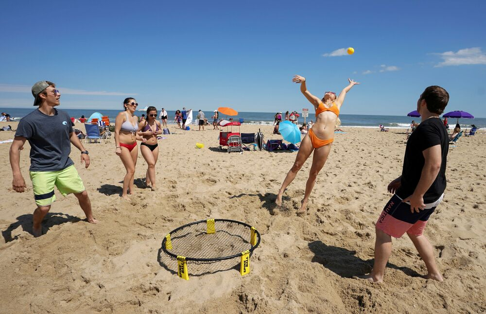 With the relaxing of the coronavirus disease (COVID-19) restrictions, beachgoers enjoy a game of Spikeball on Memorial Day weekend in Ocean City, Maryland, US, 23 May 2020.