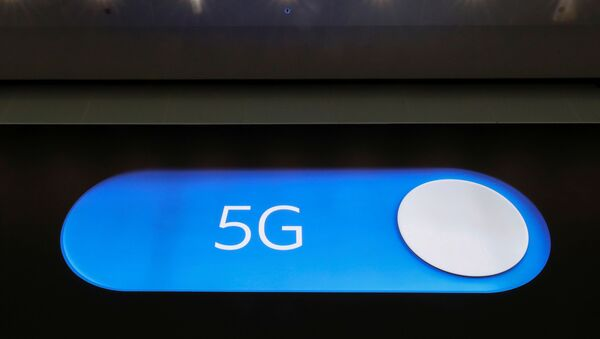 An advertising board shows a 5G logo at the International Airport in Zaventem, Belgium May 4, 2020. Picture taken May 4, 2020 - Sputnik International