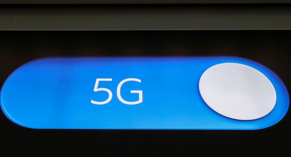 An advertising board shows a 5G logo at the International Airport in Zaventem, Belgium May 4, 2020. Picture taken May 4, 2020