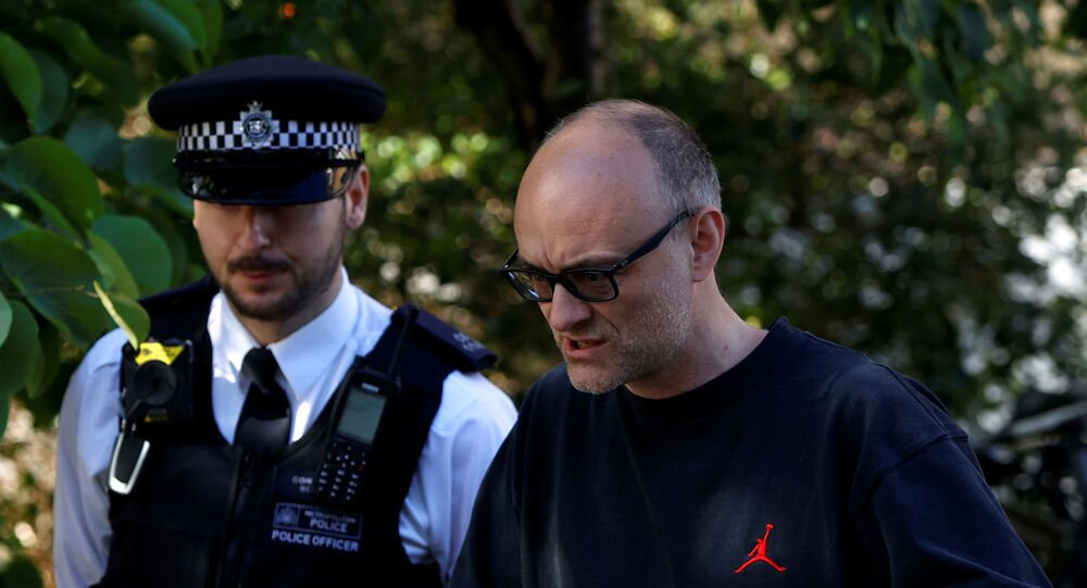 Dominic Cummings, special advisor for Britain's Prime Minister Boris Johnson, with a police officer as he leaves his home in London, following the outbreak of the coronavirus disease (COVID-19), London, Britain, May 29, 2020