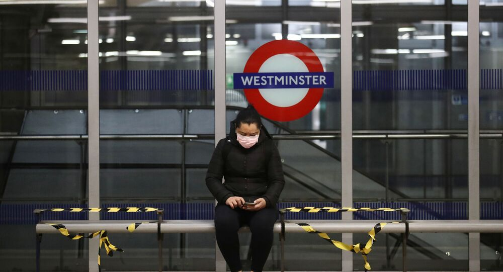 A woman wearing a protective face mask is seen at Westminster tube station, following the outbreak of the coronavirus disease (COVID-19), London, Britain, May 11, 2020.