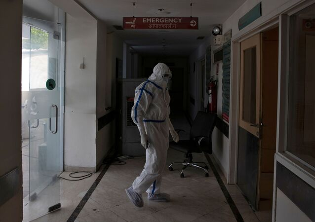 A medical worker stands outside the emergency ward for patients suffering from the coronavirus disease (COVID-19) at Max Smart Super Speciality Hospital in New Delhi