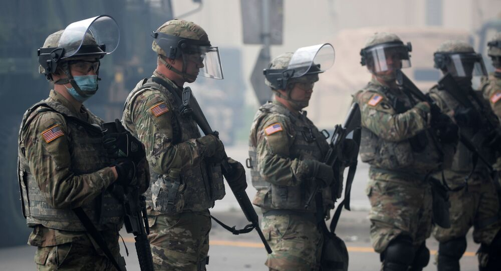 National Guard members guard the area in the aftermath of a protest after a white police officer was caught on a bystander's video pressing his knee into the neck of African-American man George Floyd, who later died at a hospital