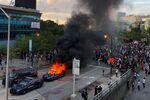 An Atlanta Police car burns as people protest against the death in Minneapolis police custody of African-American man George Floyd, near CNN Center in Atlanta, Georgia, U.S. May 29, 2020.