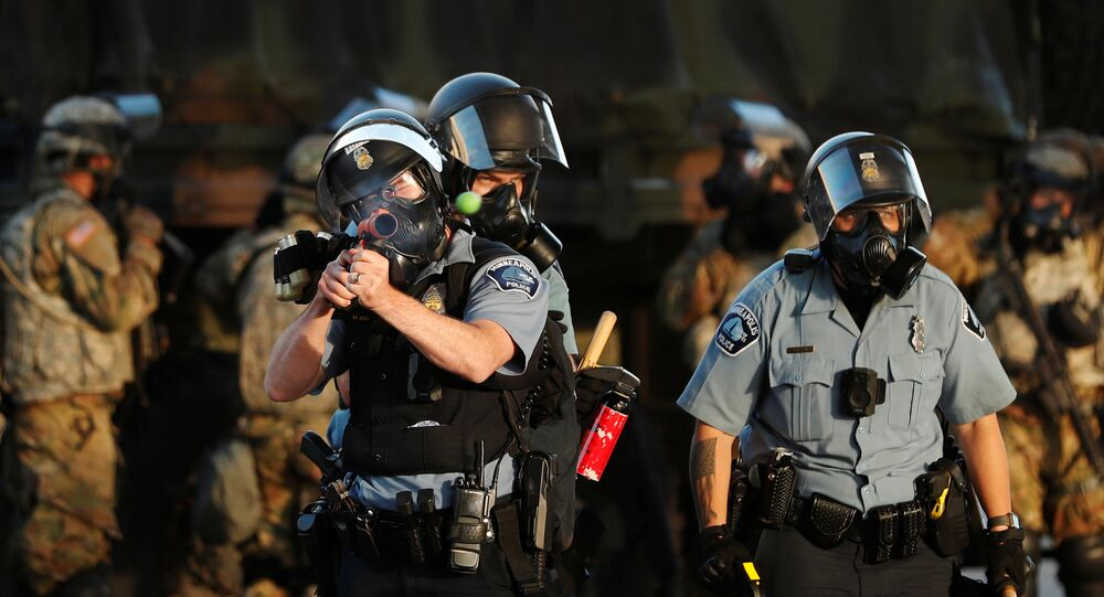 A Minneapolis Police Department officer fires a less-lethal round during continued demonstrations against the death in Minneapolis police custody of African-American man George Floyd, in Minneapolis, Minnesota, U.S., May 29, 2020. Picture taken May 29, 2020