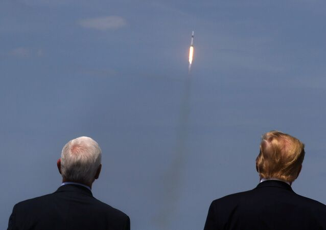 U.S. President Donald Trump and U.S. Vice President Mike Pence watch the launch of a SpaceX Falcon 9 rocket and Crew Dragon spacecraft, from Cape Canaveral, Florida, U.S. May 30, 2020.