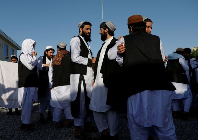 Newly freed Taliban prisoners greet each other at Pul-i-Charkhi prison, in Kabul