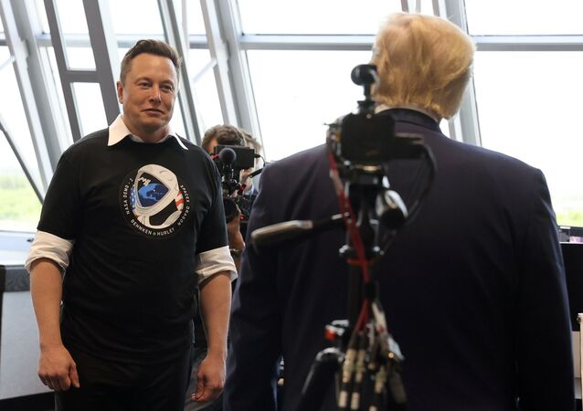 U.S. President Donald Trump and Elon Musk are seen at the Firing Room Four after the launch of a SpaceX Falcon 9 rocket and Crew Dragon spacecraft on NASA's SpaceX Demo-2 mission to the International Space Station from NASA's Kennedy Space Center in Cape Canaveral, Florida, U.S. May 30, 2020.