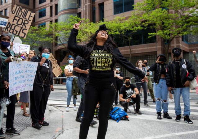 Patience Evbagharu gives a speech outside Toronto Police headquarters as protesters march to highlight the deaths in the U.S. of Ahmaud Arbery, Breonna Taylor and George Floyd, and of Toronto's Regis Korchinski-Paquet, who died after falling from an apartment building while police officers were present, in Toronto, Ontario, Canada May 30, 2020.