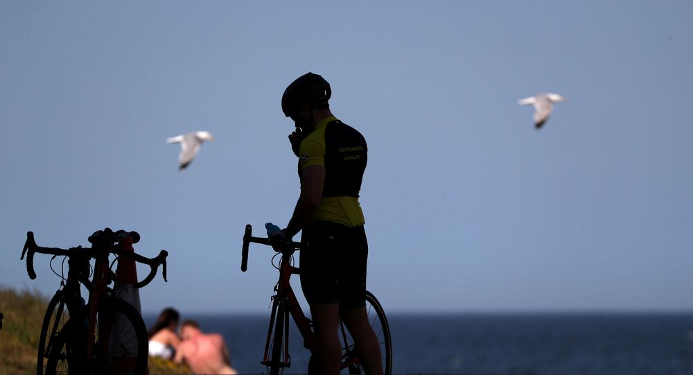 A cyclist is seen in St Andrews as Scotland eases lockdown restrictions following the outbreak of the coronavirus disease (COVID-19), St Andrews, Scotland, Britain, May 29, 2020.