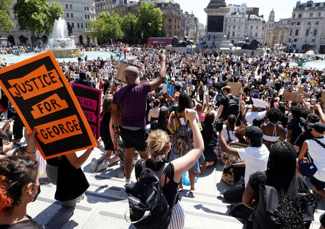 People react during a protest against the death in Minneapolis police custody of African-American man George Floyd, in Trafalgar Square, London, Britain, May 31, 2020.