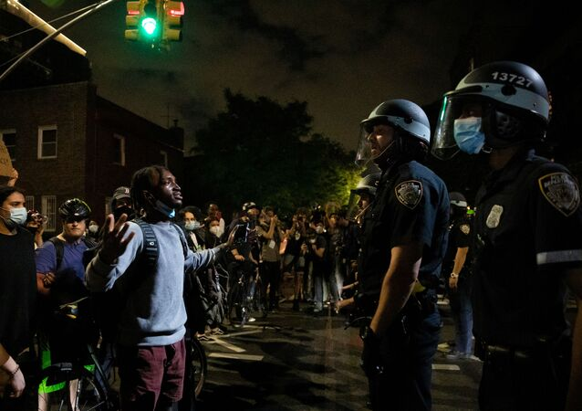 A protester argues with a NYPD police officer