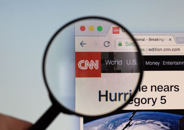 CNN logo on a computer screen with a magnifying glass