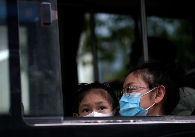 People wearing face masks are seen on a bus following an outbreak of the novel coronavirus disease (COVID-19), in Shanghai, China May 31, 2020.