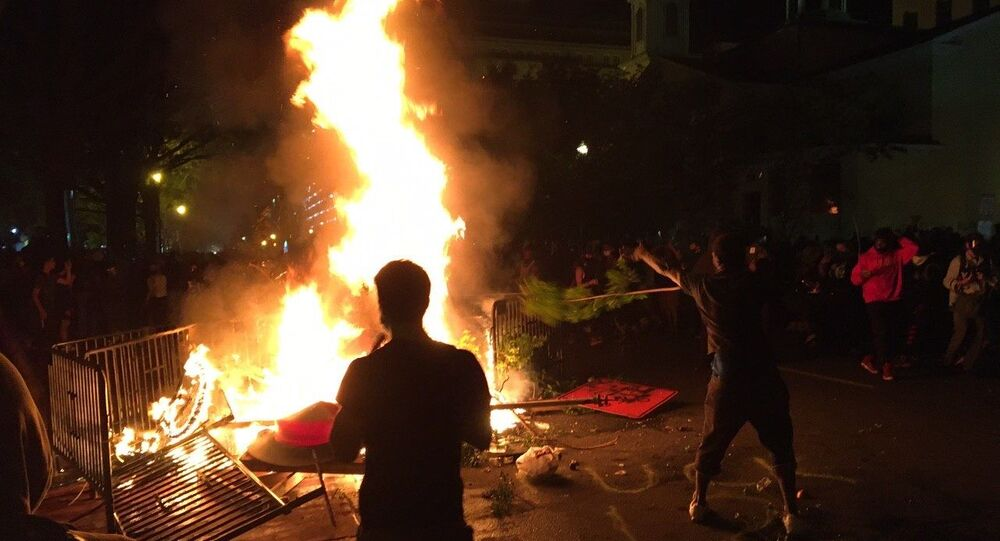 Protesters kindle fire near White House