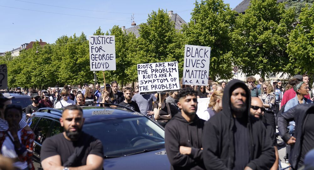 People demonstrate in front of the US Embassy in Copenhagen, Denmark, on May 31, 2020, to express their feelings in regard to the death of 46 year old George Floyd, an unarmed black man who died during his arrest in Minneapolis on May 25, 2020.